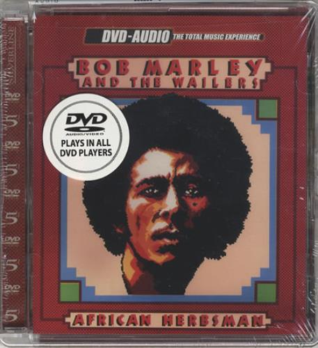 Clamshell storage case for a DVD-Audio disc entitled African Herbsman from Bob Marley and the Whalers. Note a specific reference is made that this disc is compatible or plays in all DVD players.
