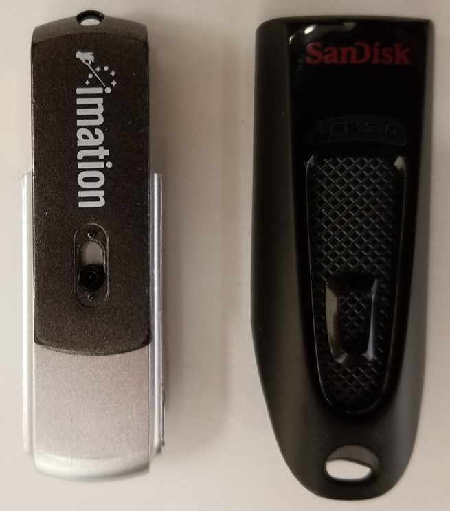 Two USB flash drives with the connector interface protected. On the left, a swivel portion of the shell provides protection. On the right the connector is retracted into the shell.