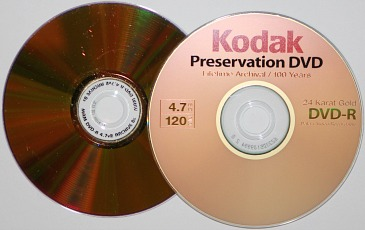 Two gold archival DVD-Rs for the long term storage of digital information. Shown is a Kodak Preservation 4.7 GB DVD and a MAM Archival Gold 4.7 GB DVD.