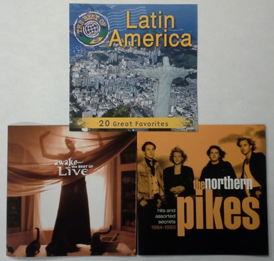 Liner notes or audio CD booklets found in jewel cases for the bands Live and The Northern Pikes. Also shown is the jewel case insert for a CD on Latin American music.