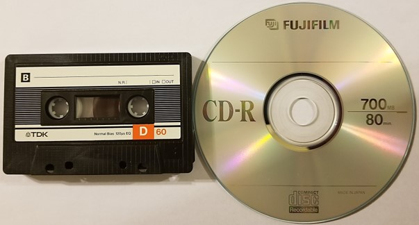 An audio cassette tape and a recordable CD or CD-R. Conversion of the analog cassette to digital form, either a CD-R or digital file, is necessary for preservation of the content.