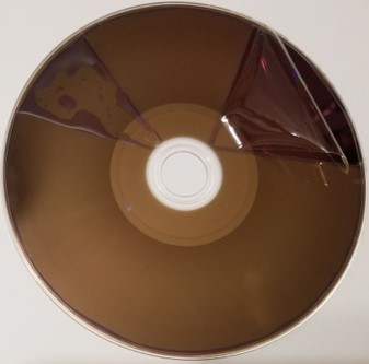 Hard coat layer peeled off of a BD-R or recordable Blu-ray disc. The hard coat layer provides extra protection against scratches, dust and dirt, and fingerprints.