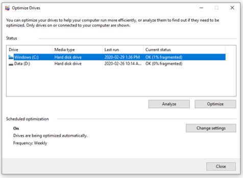 A screen capture of the Optimize Drive window where a hard disk is selected, analyzed, and defragmenting hard drive occurs.