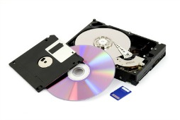 A variety of digital storage media for storing digital photos such as an optical disc, flash card, and hard drive.