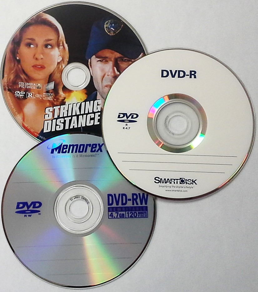 A variety of DVD formats such as a movie DVD of Striking Distance with Bruce Willis, a DVD-R or recordable DVD by SmartDisk, and a DVD-RW or erasable DVD from Memorex.