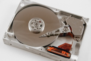 opened hard drive for digital scrapbook storage showing hard disks and read heads