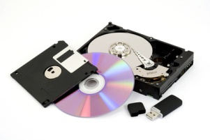 Storage media for storing digital photos and other digital files. Media such as optical discs, hard disk drives, floppy diskettes, and USB flash drive are shown.