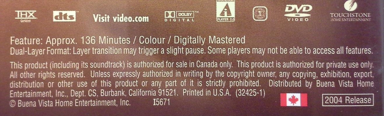 Back side of the packaging of a dual-layered DVD movie disc showing the statement that there will be a slight pause as the laser transitions between the information layers of the DVD.