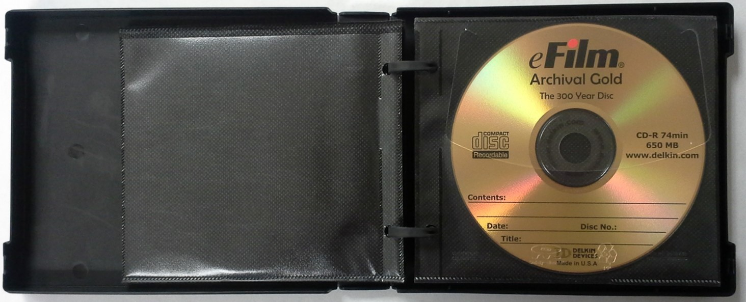 A cd wallet or storage album with sleeves. A chemically stable gold disc is stored inside of the album.