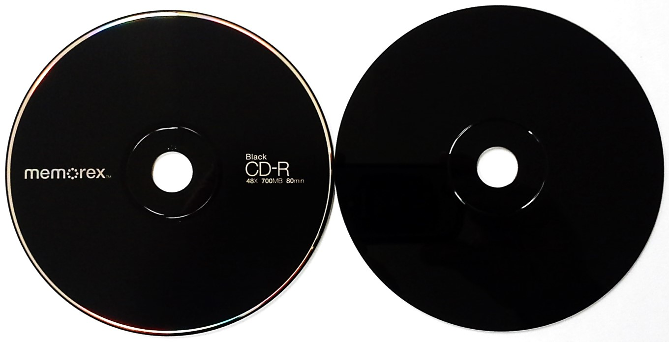A black CD-R from Memorex. This disc is often light green in color because it would use the phthalocyanine dye and silver alloy metal. A pigment, added to the base, alters the appearance of the disc.