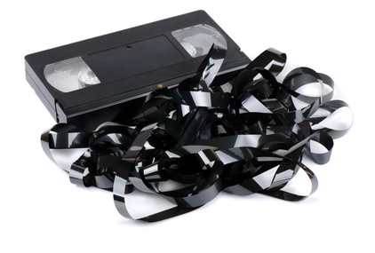 Badly wrinkled and damaged VHS video cassette tape might be repairable with splicing for breaks or heat and pressure for smoothing out the wrinkles.